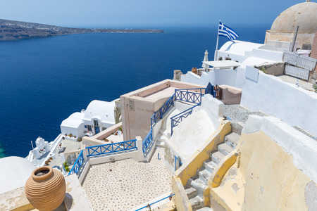View From Oia, The Most Beautiful Village of Santorini Island In Greece photo