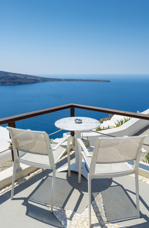 balcony view: Chairs With Beautiful View To Relax in Santorini, Greece Stock Photo