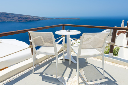 hotel balcony: Chairs With Beautiful View To Relax in Santorini, Greece Stock Photo