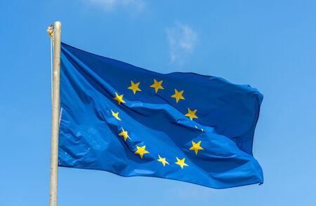 Waving European Union Flag Against The Blue Sky photo