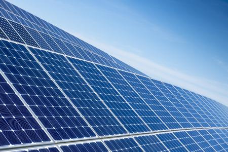 Solar Panels Against The Deep Blue Sky 写真素材