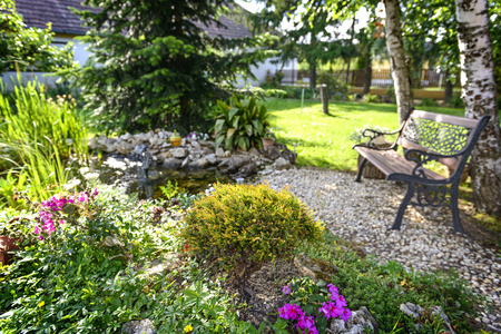 Beautiful Garden With Bench And Little Pond To Relax Stok Fotoğraf