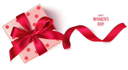 Decorative gift box with red bow and long ribbon. Happy womens day text
