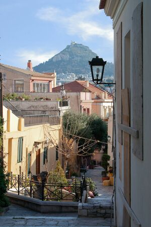 sity: A road to the old sity of Athens. At the background the Likavitos hill