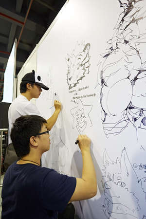 role play: People drawing on the white board at 2015 DL Anime Carnival in Guangzhou, China