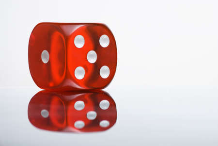 Red dice with reflection