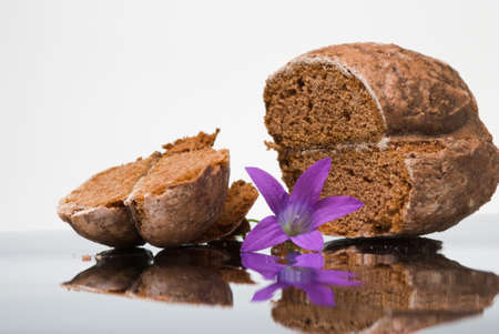 Sliced off honey cake and small flower