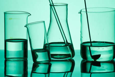 Group  of laboratory glassware filled with liquid