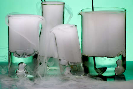 Laboratory glassware during experiment with erupted vapors Stock Photo