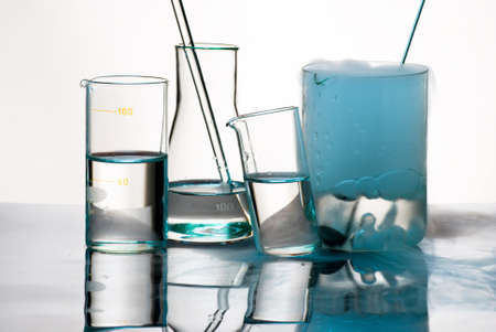 Laboratory glassware during experiment with erupted blue vapors