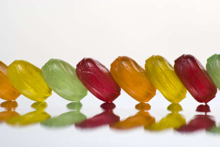 Row of bonbons with interesting reflection Stock Photo