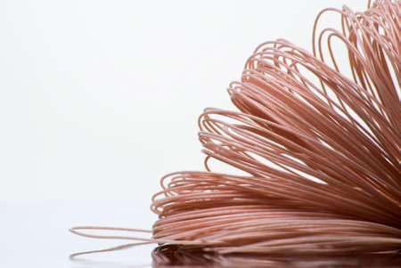 copper background: Skein of coated cooper wire