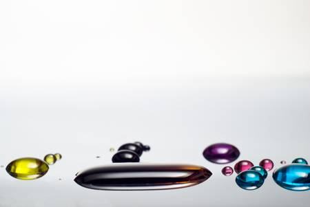 Colorful liquid drops on metal surface