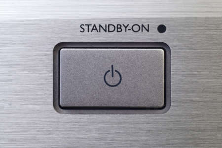 Close up of stadby button on brushed metal background