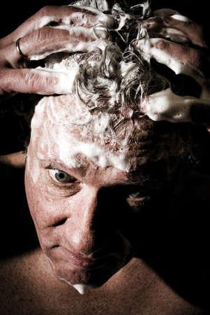 Close up of a man washing his hair Stock Photo