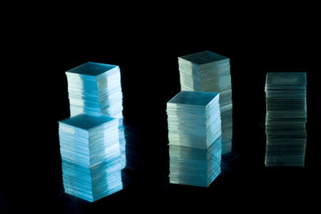 Stacks from thin glass on black background photo