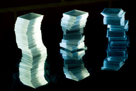 Stacks from very thin square glass on reflective surface