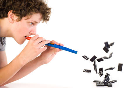 Boy with fife in front of flying domino