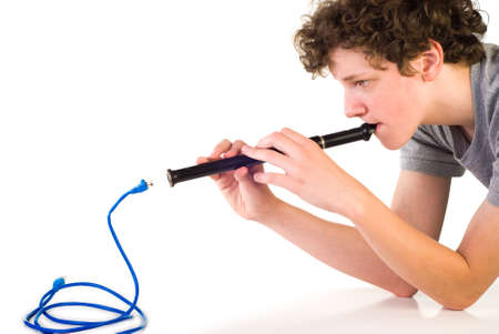 Boy with fife in front of network cable in the form of a cobra
