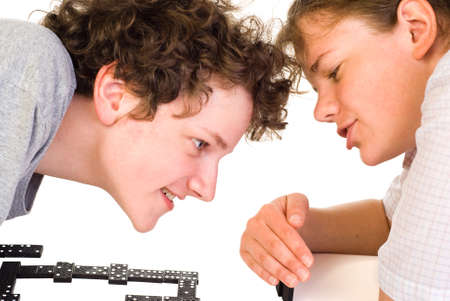 Boy and girl playing dominoes with fun Stock Photo