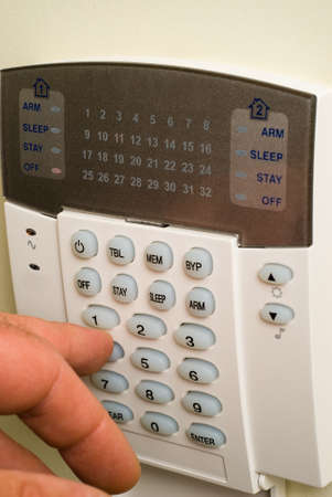 Pressing button on a home security system Stock Photo - 10222966