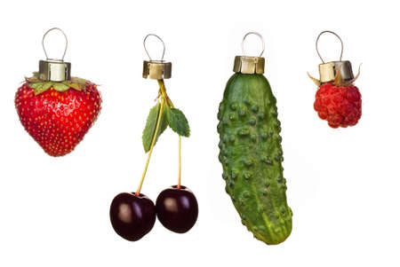 Fruits and vegetable prepared as Christmas tree decoration isolated on white