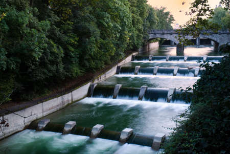 Cascades at the isar river in munich at dusk