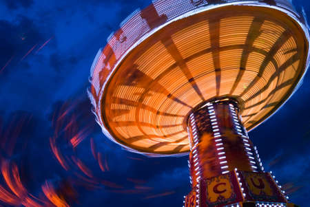 Chairoplane at the oktoberfest in munich at night Stock Photo