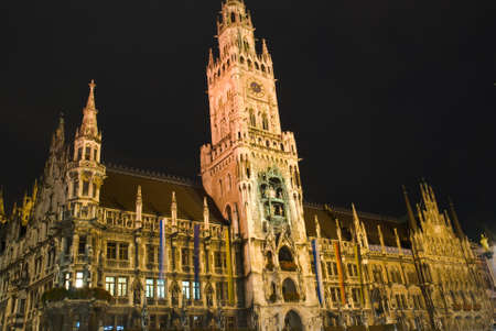 The night scene of town hall at the Marienplatz in Munich. The image was taken during octoberfest on rainy day Stock Photo
