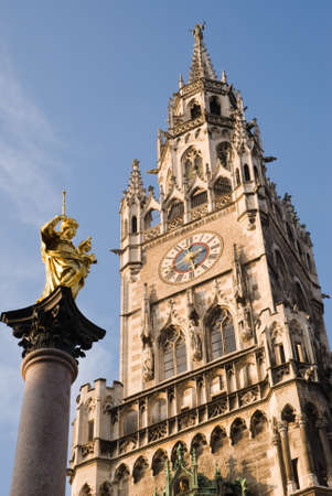 mediaval: The statue of Maria and the Munich mediaval town hall. Stock Photo