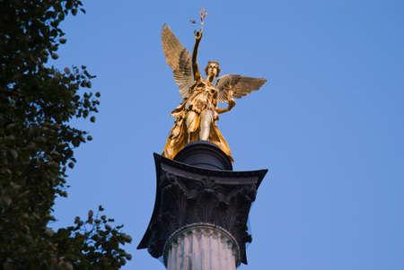 Friedensengel in munich - in front of blue sky photo