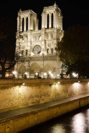 Paris Notre Dame Cathedral and the Seine river at night