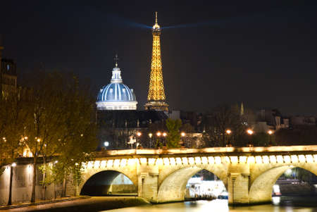 Eiffel Tower and Dome of the Institut de France at night