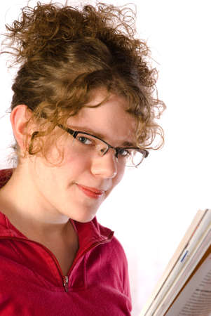 Beautiful girl in glasses reads magazine