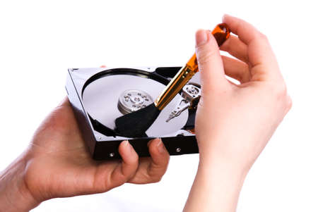 Cleaning open hard disk with brush