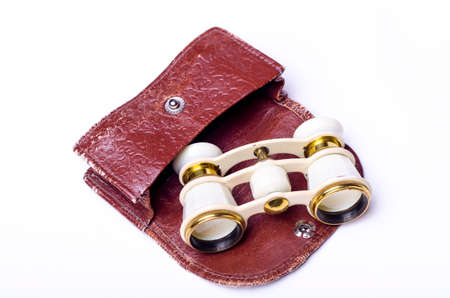 Old fashioned opera glasses with case on white