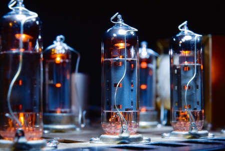 Glowing vacuum electron tubes of vintage guitar amplifier photo