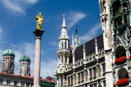 The city hall and the Virgin Mary column at the Marienplatz in Munich Stock Photo