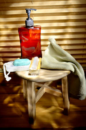 pleated: Hygiene items on table with pleated blinds in background