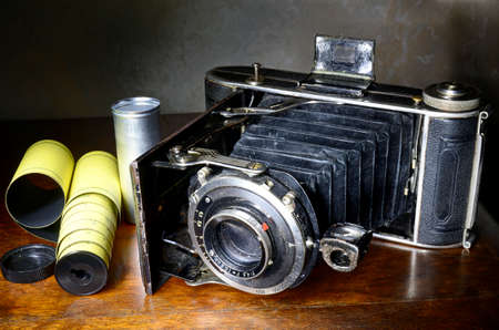 folding camera: Antique bellows camera and original film used with this camera Stock Photo