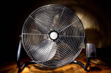 electric grid: Black industrial electric fan with grid Stock Photo