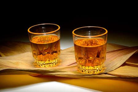 Whiskey shots on a dry leaves surface Stock Photo