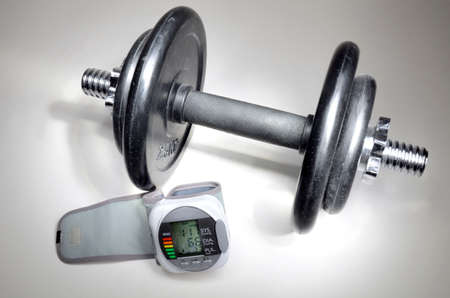 blood sport: Iron dumbbell and pressure measuring device used in medicine