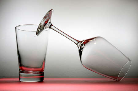 Empty glasses on the table in front of a gray background Stock Photo