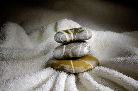 Still life with stacks of pebbles on towel