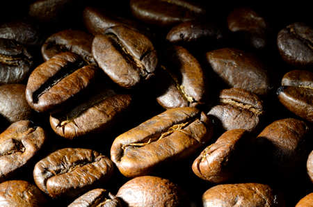 Close up of  roasted coffee beans heap