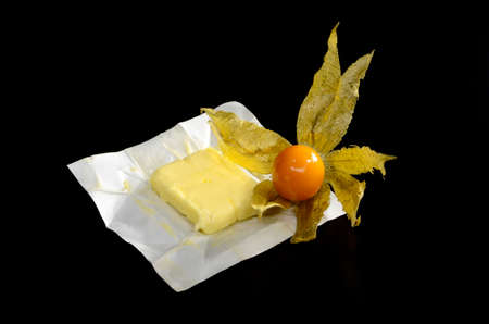Physalis and butter on black background Stock Photo