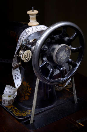 Retro sewing machine from pulley side and tape measure