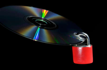 Compact disk with lock on it. Data protection concept.