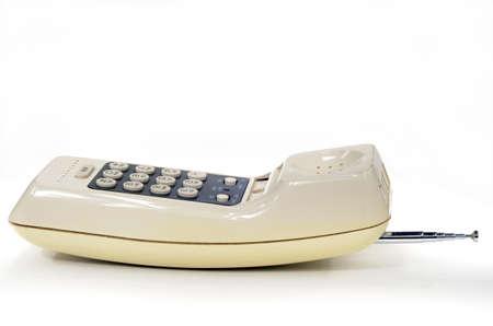 Old radio telephone handset on white background